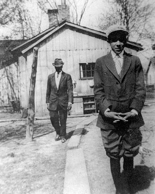 Langston Hughes, foreground, shown in his boyhood hometown of Lawrence, Kan., circa 1914....
