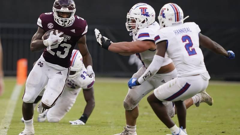 Mississippi State running back Dillon Johnson (23) runs along the sideline as Louisiana Tech...
