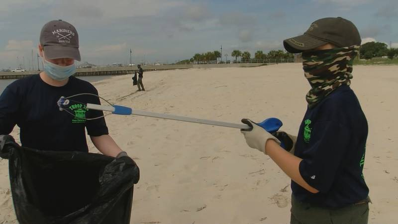 Boy Scouts Troop 316 cleaning the beach in Pass Christian.