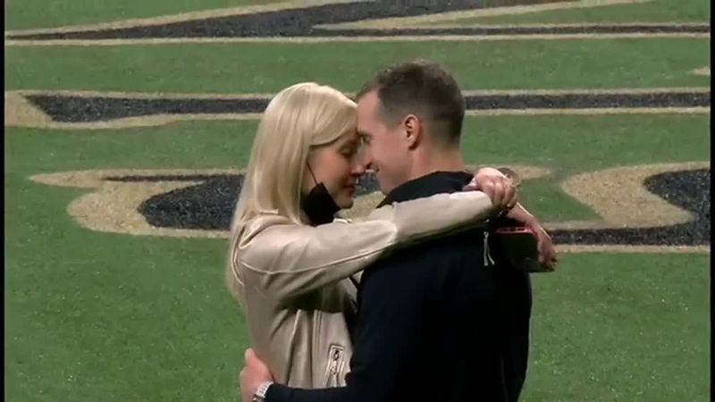 Brees takes a moment on field with family