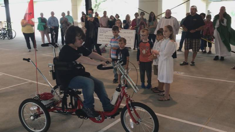 Danny, 12, can now ride with his friends thanks to his new custom-fitted trike .