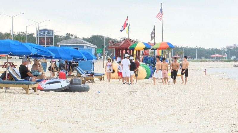 The beach quickly filled with holiday visitors with one thing in common. And that's enjoying...