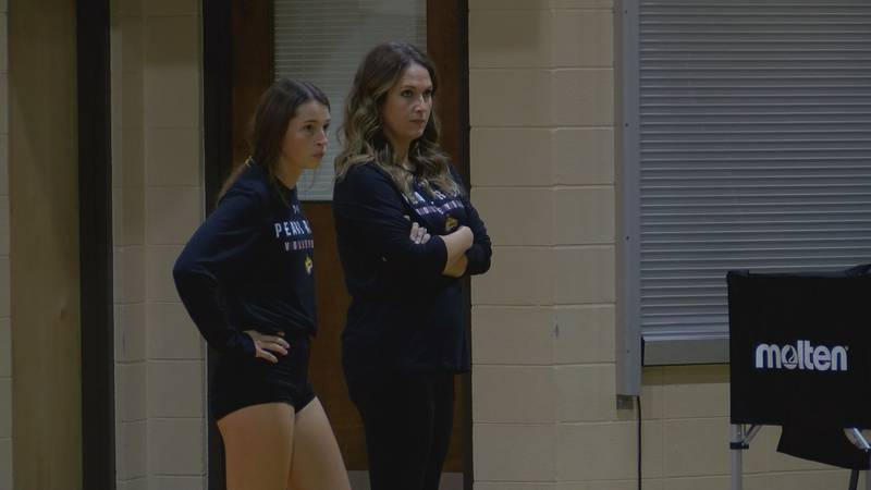 Sydney Salter and coach Haley Chatham watch volleyball practice.