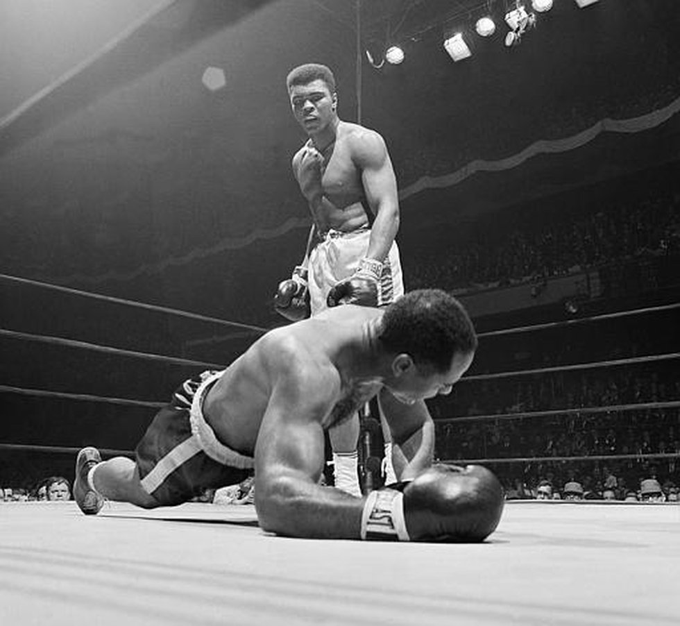 Zora Folley, left, moves in on champion Cassius Clay (Muhammad Ali) in first round of their...