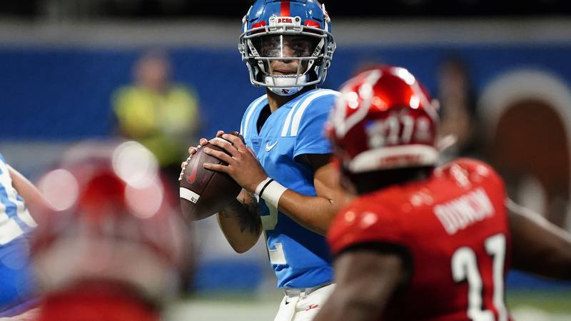 Mississippi quarterback Matt Corral (2) looks for an open receiver during the first half of an...