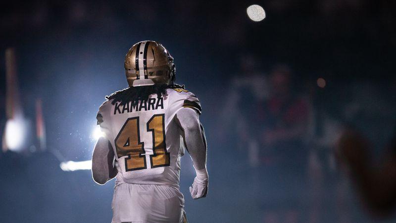 Saints running back Alvin Kamara is introduced to Saints fans inside a dark Superdome