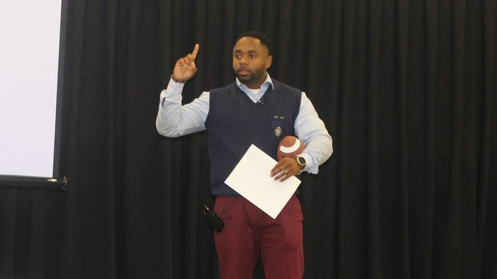 Abra Taylor talks to young men at the Young Males to Success Summit this past summer.