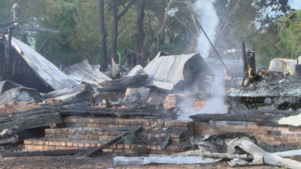 No one was in either home at the time of the fire. (Photo source: WLOX News)