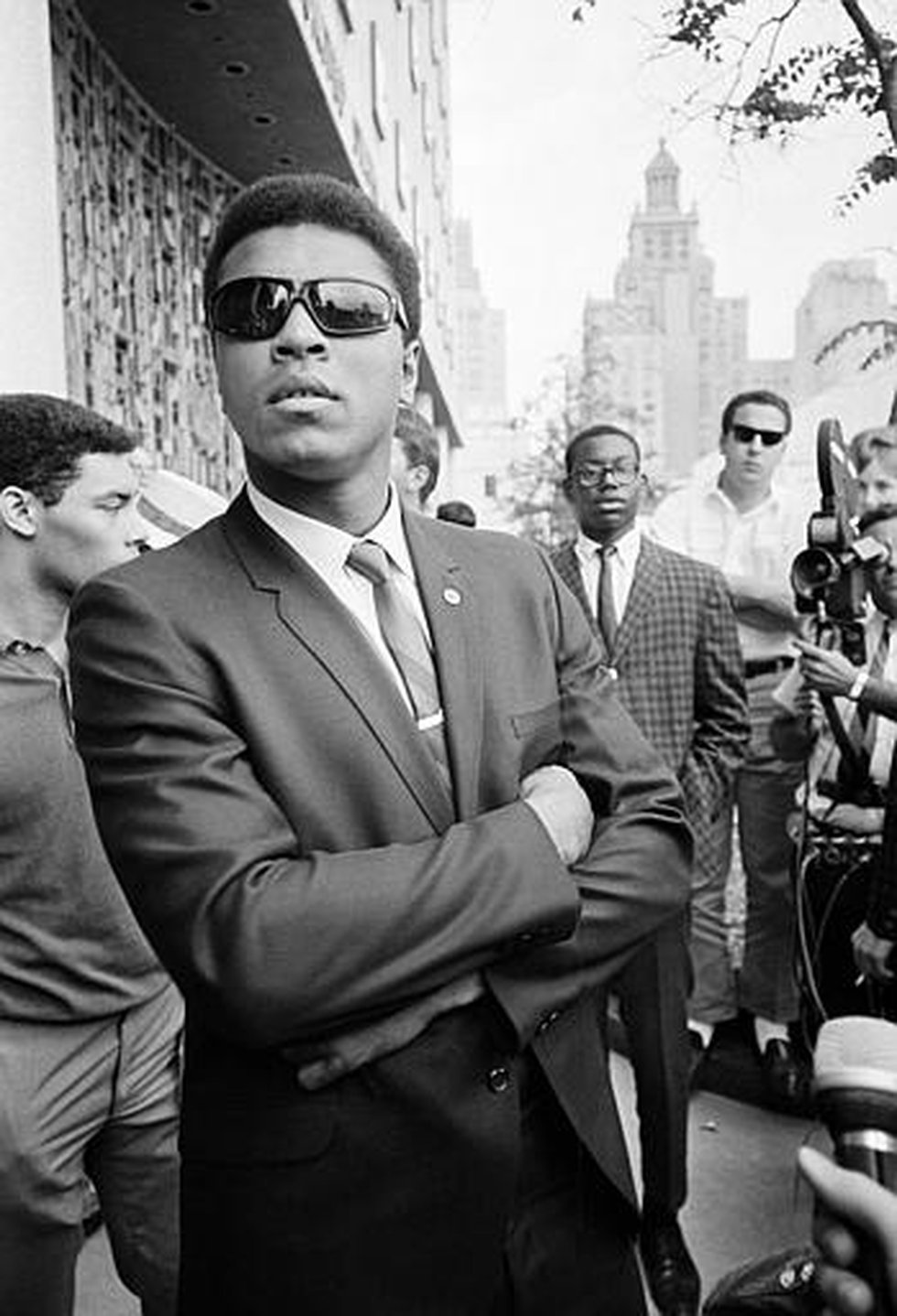 Heavyweight champion Muhammad Ali stands outside the federal court house in Houston following a...