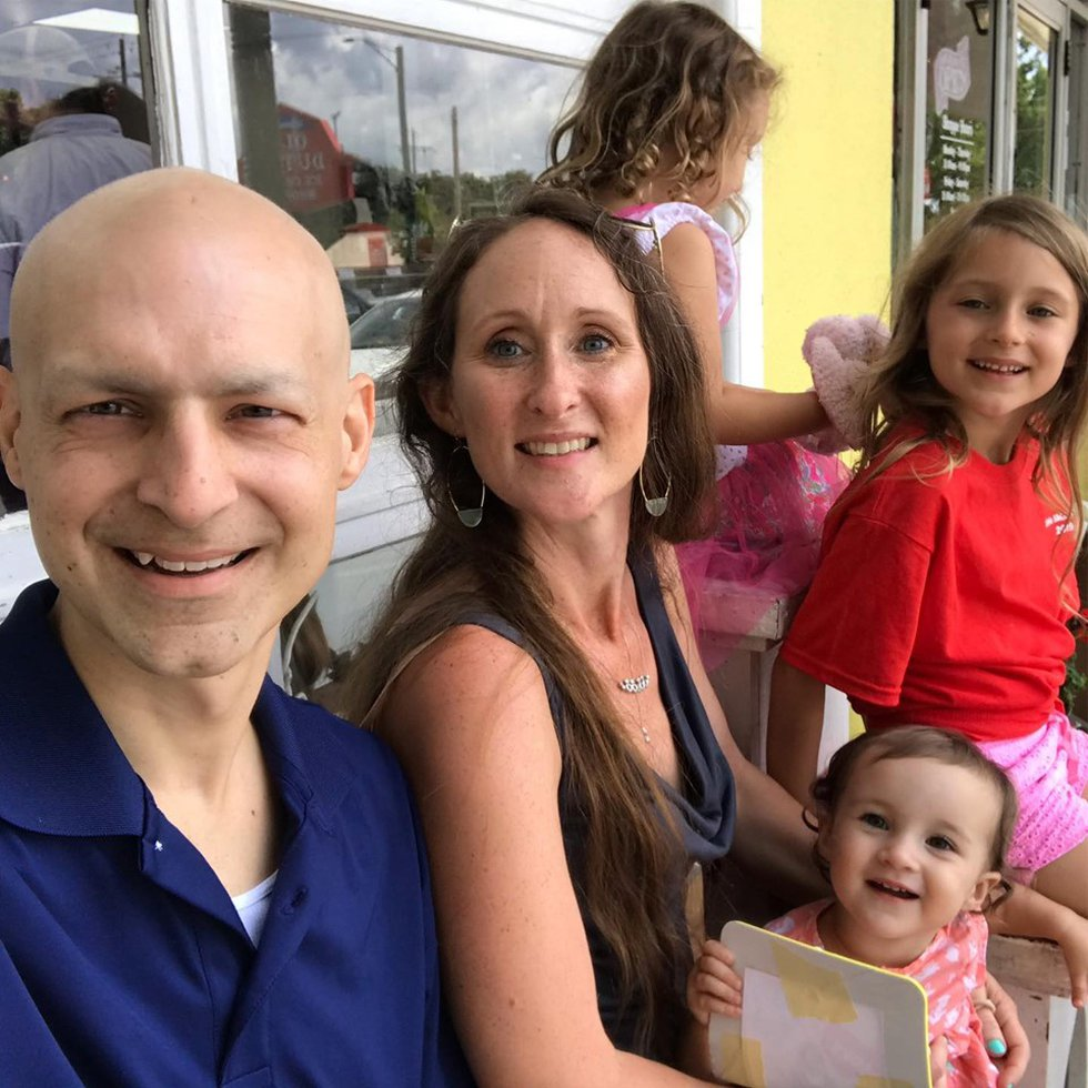 Sean and Amy Delcambre pose for a photo with their daughters in July, less than a month before...