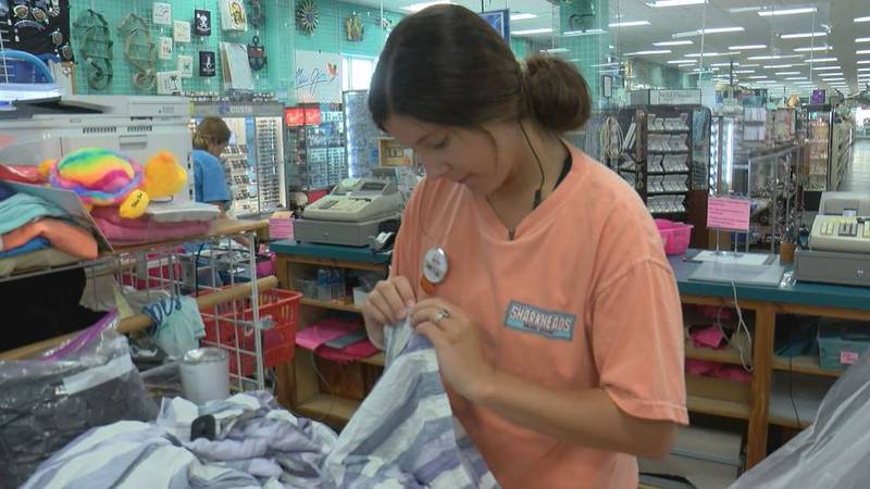 Businesses, especially those in the tourism industry like Sharkheads souvenir shop, are having...