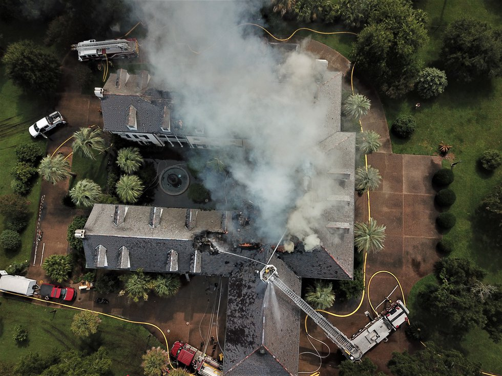 Drone video captured by Pat Sullivan shows firefighters working to extinguish the fire at Pass...