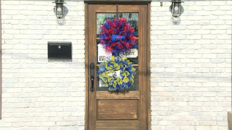 PHS & RCS wreaths hang on the front door at Lemon Mohler Insurance Agency in Pascagoula.