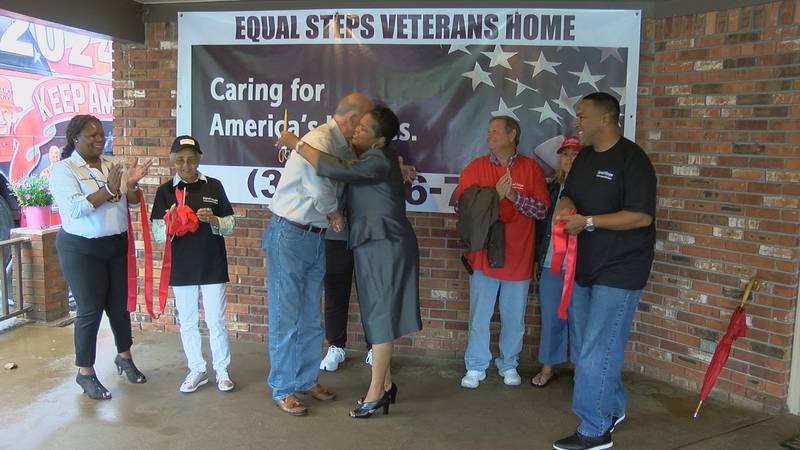 Equal Steps Executive director hugs Long Beach Mayor George Bass after they cut the ribbon on...
