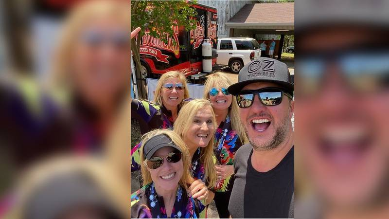 """Members of the """"Wolf River Biker Babes"""" take a selfie with Country music star Luke Bryan..."""