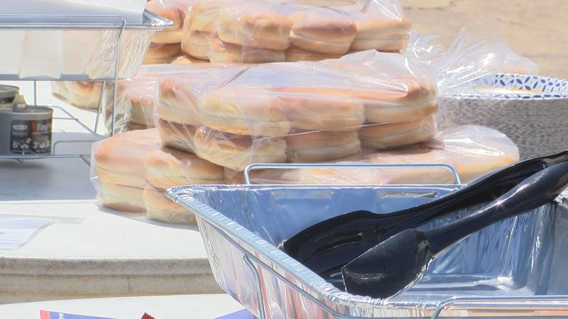 The organization fed first responders hot dogs, hamburgers, snow cones, and chips free of charge.
