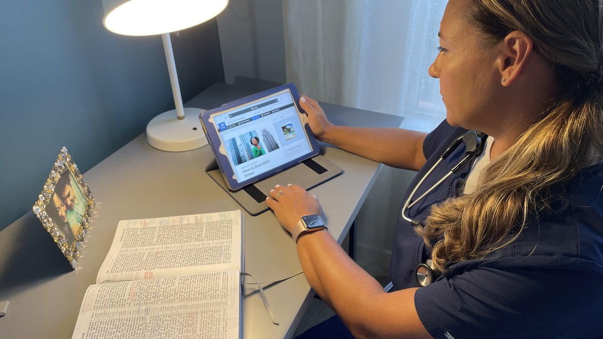 A frontline healthcare worker studies the Bible using a Jehovah's Witness online study aid.