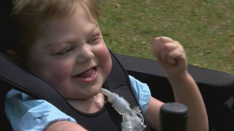 Preston Jones, 5, of Carriere smiles Monday as he rides in his new Trackchair donated by...