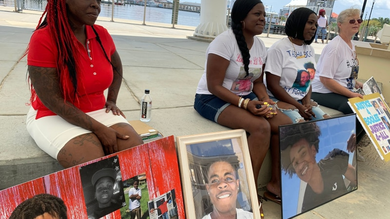 The families of gun violence victims Todd Miller, Robert Tatum, and Marcello English.
