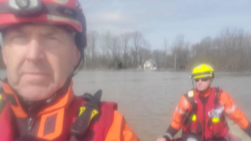Biloxi Firefighters help rescue flood victim