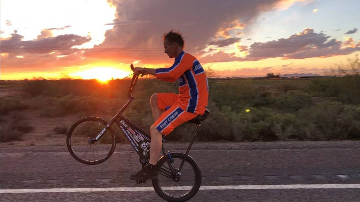 Kurt Osburn is riding cross country to set the world record for longest wheelie and raise money...