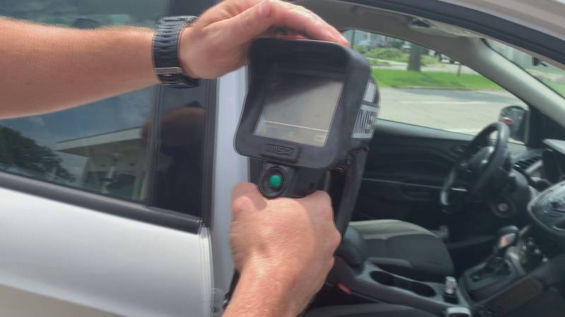 A Gulfport firefighter uses a thermal imaging camera to show how hot it gets inside a vehicle...