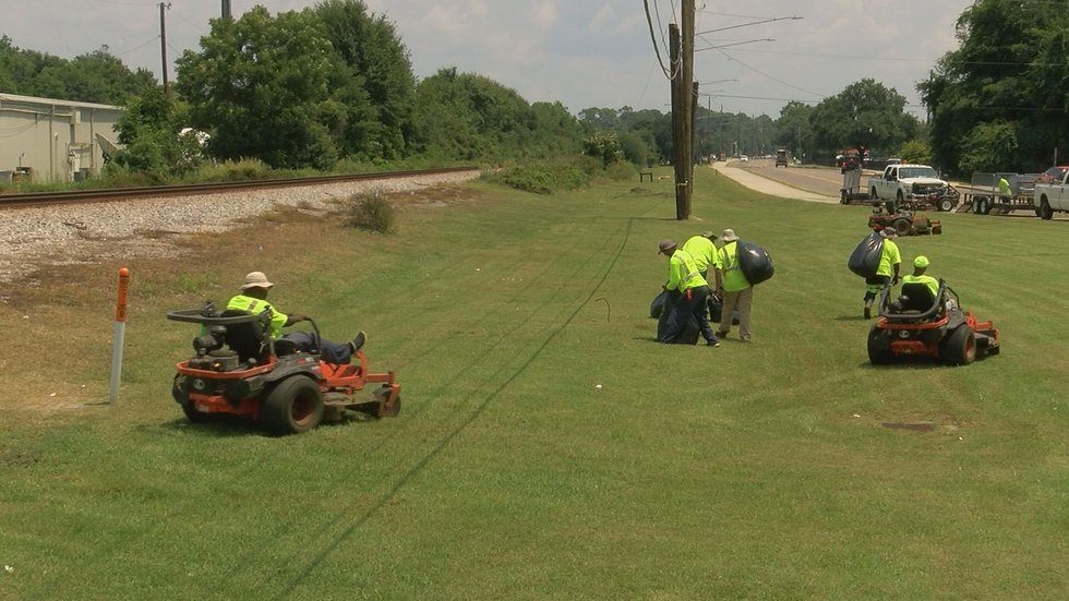 A Biloxi public works crew cuts the grass along the CSX right-of-way on Aug. 14, 2019. Coast...