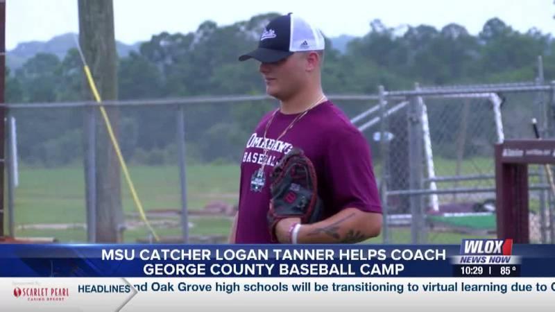 Logan Tanner helps coach George County baseball camp