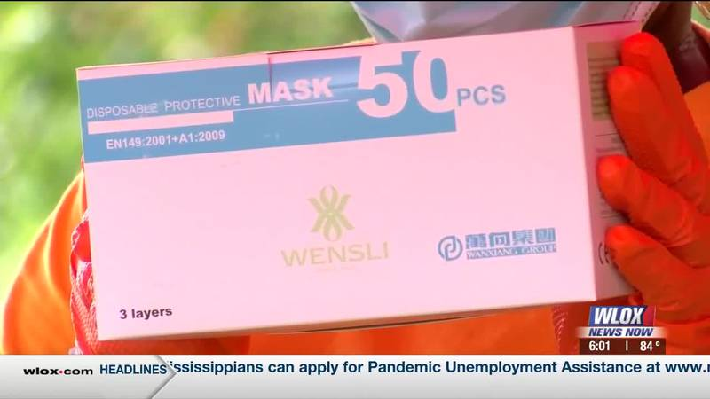 NAACP volunteers in Moss Point helped residents stay safe by giving away free face masks on...
