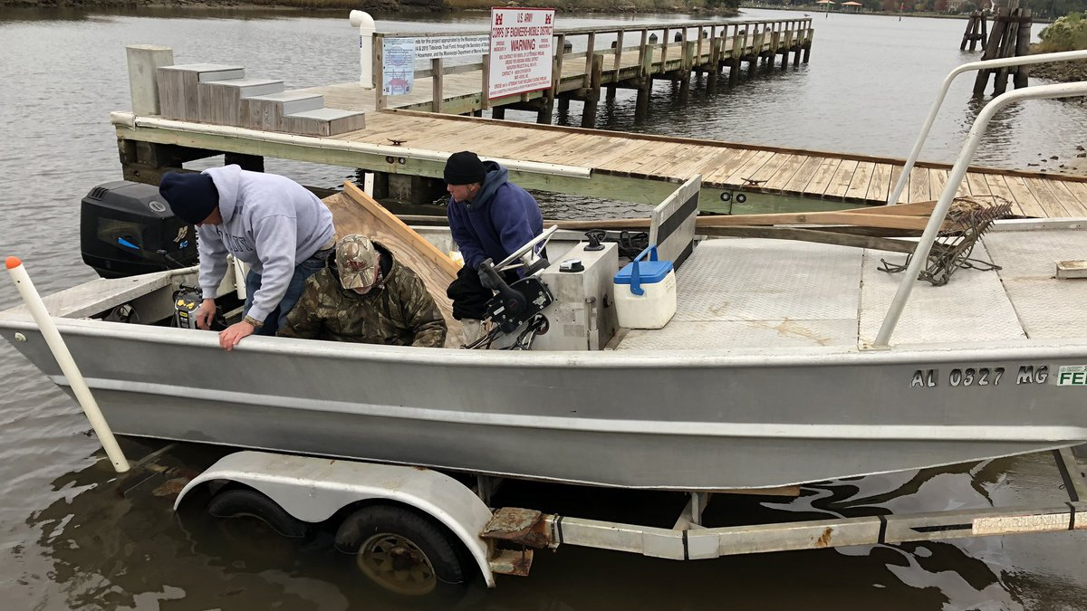Beginning at daybreak Monday, fishermen worked to catch oysters using tongs and move them to a...