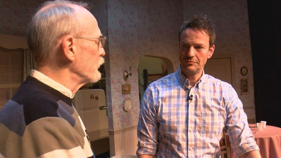Center Stage artistic director Chuck White, left, works with actor David Slatten, who will...