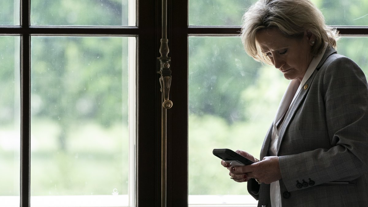 Sen. Cindy Hyde-Smith, R-Miss., check her mobile phone on Capitol Hill, Tuesday, June 8, 2021,...