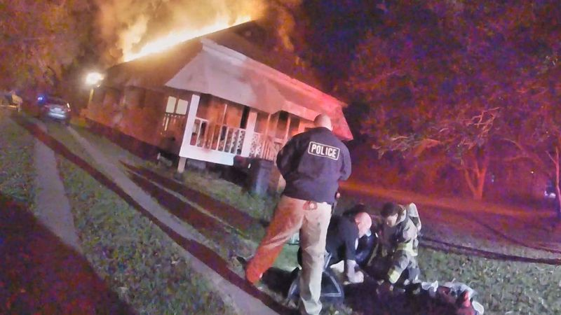 Body cam footage from a Bay St. Louis police officer shows first responders working to save the...