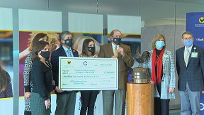 The State's only children's hospital received the check during ceremony at UMMC Tuesday.