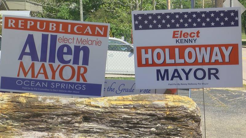 Campaign signs for both candidates are displayed along Government St. in Ocean Springs.