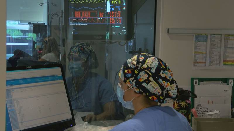 A nurse charts patient's care in one of the four intensive care units the hospital has.