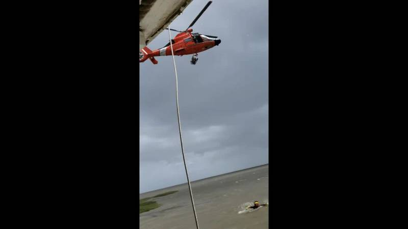An air crew from Coast Guard Air Station New Orleans rescued two people who became stranded on...