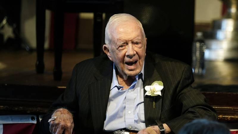 FILE - Former President Jimmy Carter reacts as his wife Rosalynn Carter speaks during a...
