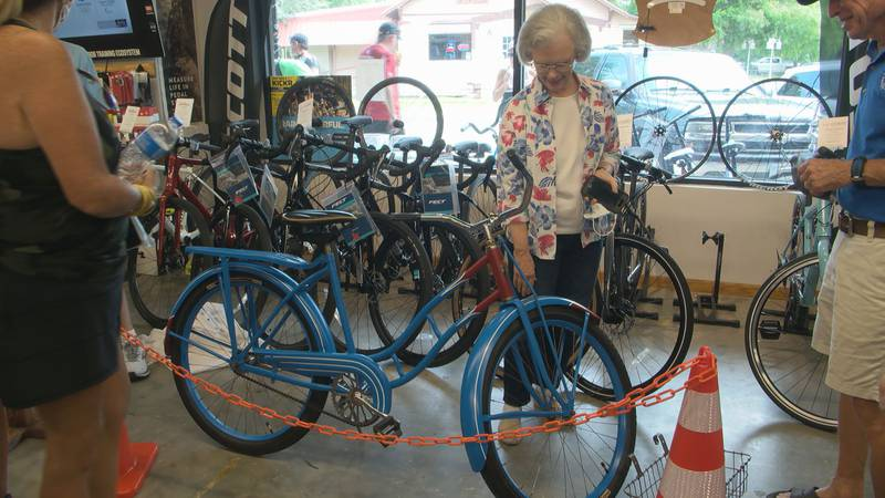 A crowd of bikers packed Tri Hard Sports after their Saturday morning ride. They were all here...