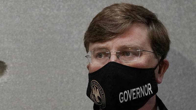 Mississippi Gov. Tate Reeves listens as state emergency management executive director Greg...