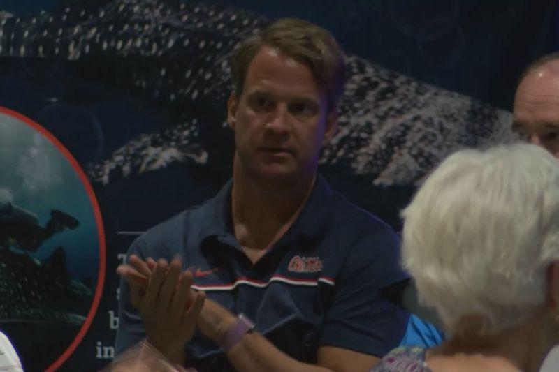 Lane Kiffin applauds at the 2021 Rebel Road Trip stop in Gulfport.