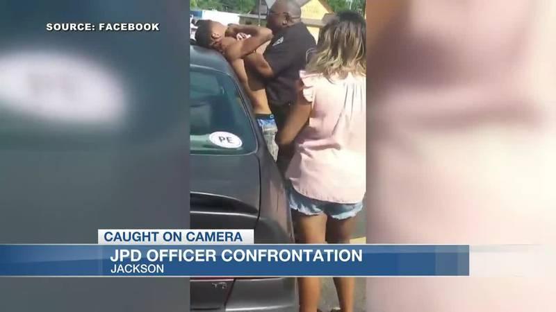 JPD officer on leave after confrontation