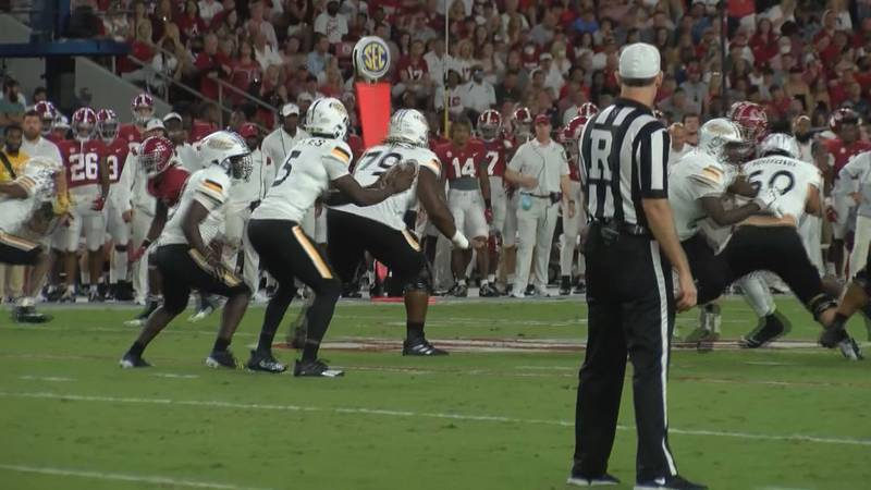 Ty Keyes takes the snap for Southern Miss against Alabama