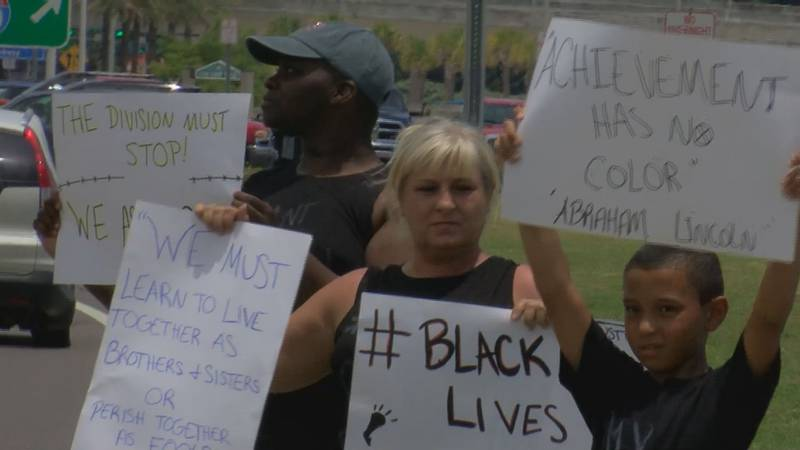 Protesters demonstrate on Saturday against the death of George Floyd who died while being...