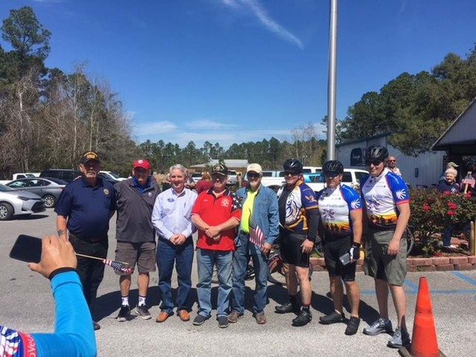 Participants in the 'Ride 2 Recovery' event pose for a photo (photo credit: WLOX)