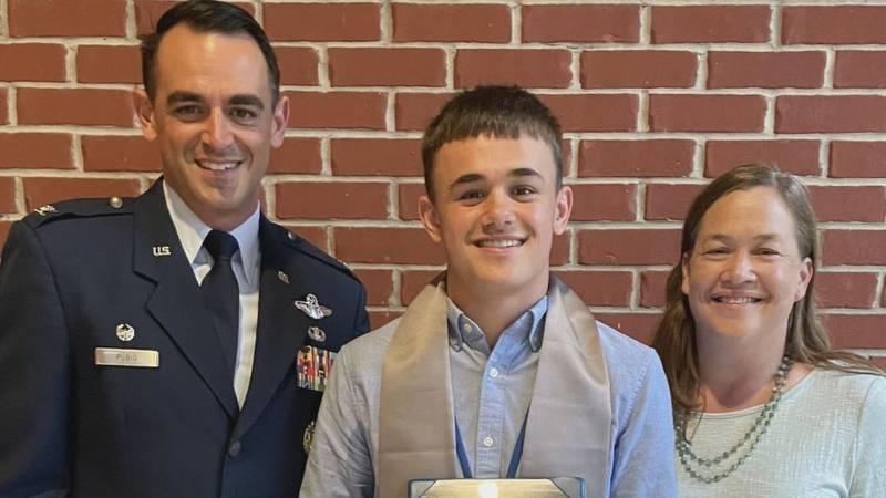 Ashton Rubio, center, and his parents, Col. Stuart Rubio and Megan Rubio, celebrate Ashton's...