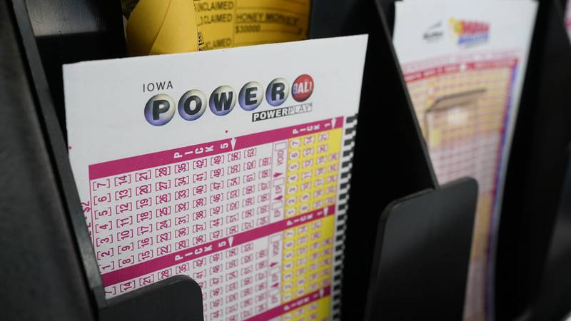 FILE - In this Jan. 12, 2021 file photo, blank forms for the Powerball lottery sit in a bin at...
