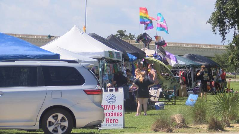 People were dressed in their rainbow attire as they gathered at the Point Cadet Plaza in Biloxi...