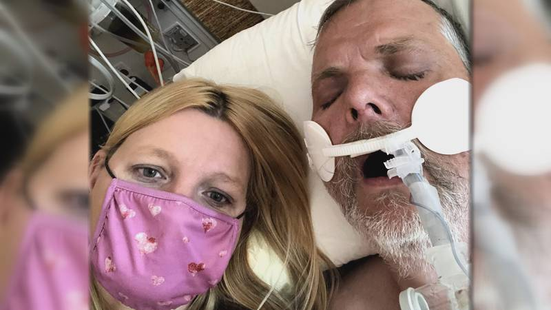Leslie Wrigley sat by her husband's bedside for weeks while he battled COVID-19.
