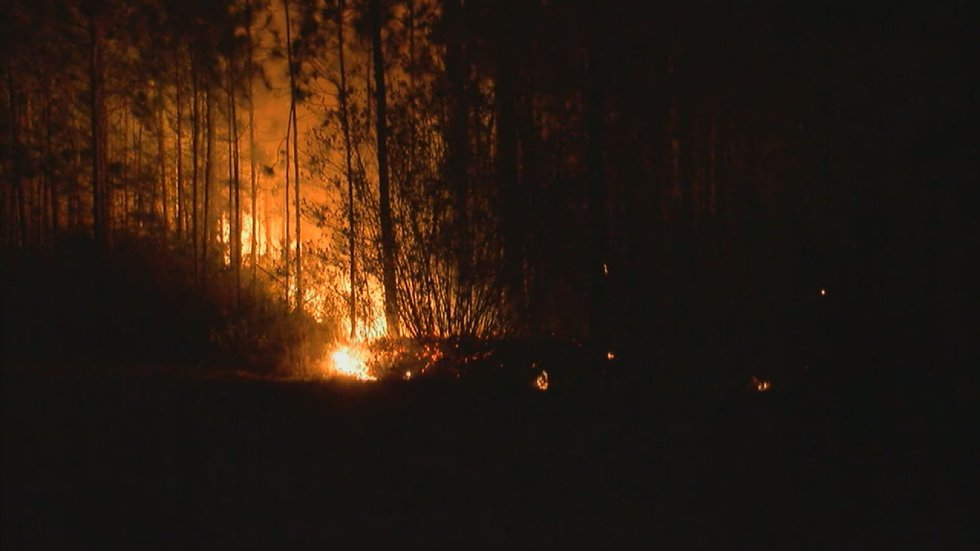 The fire affects a large number of acres near Long Beach. (Photo source: WLOX News)